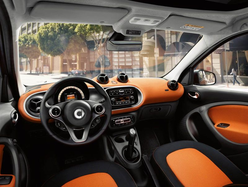 detail shot: passion and edition 1#, dashboard and door centre panels in orange fabric, accent trim parts in black/grey and seats with black/orange fabric upholstery, 3-spoke multifunction steering wheel in leather copyright: full buyout